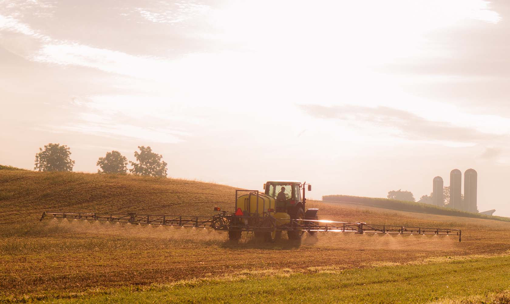 Farm equipment spraying crops